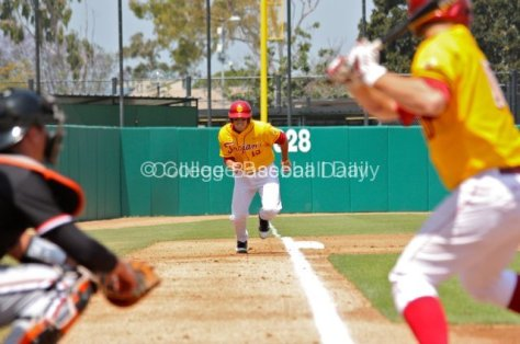 James Roberts charges down the third base line.