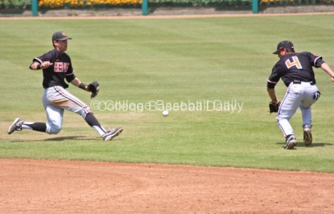 Oregon State's middle infielders try to cut off a bouncing grounder.