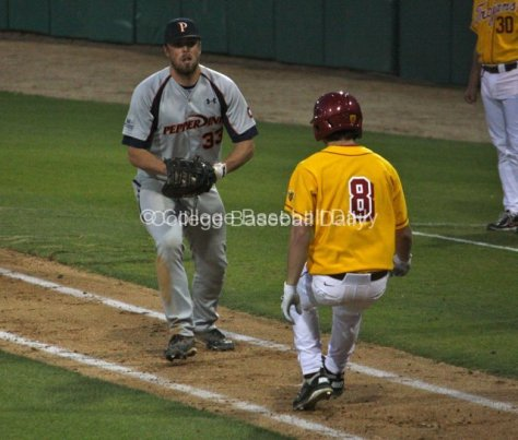 Sam Meyer tries to tag out J.R. Aguirre.