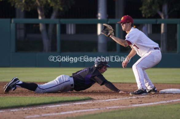 Jayce Ray gets back to first base.