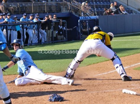 Louie Lechich slides in safely.