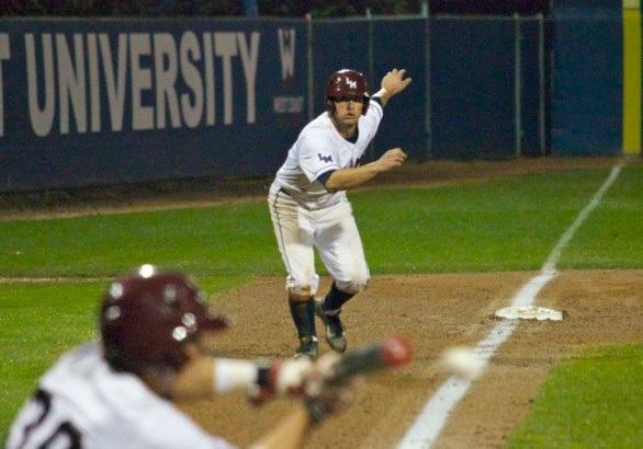 Tommy Cheek watches a squeeze bunt attempt.