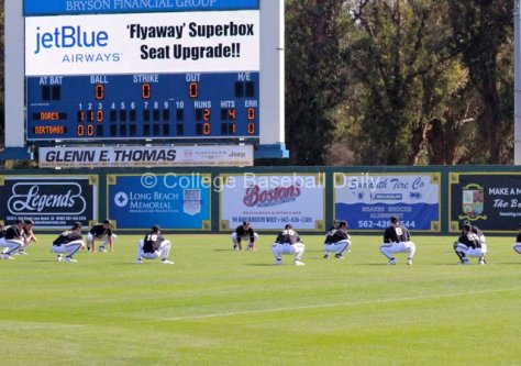 Vanderbilt performs synchronized team stretches between innings. (Photo: Shotgun Spratling)