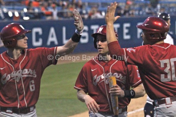 Ian Sigdal, Cameron Frost and Nick Tanielu celebrate the go-ahead runs.
