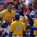 Jun 20, 2016; Omaha, NE, USA; UC Santa Barbara Gauchos second baseman JJ Muno (9) scores a run and celebrates with teammates against the Miami Hurricanes in the 2016 College World Series at TD Ameritrade Park. UC Santa Barbara won 5-3. Mandatory Credit: Bruce Thorson-USA TODAY Sports