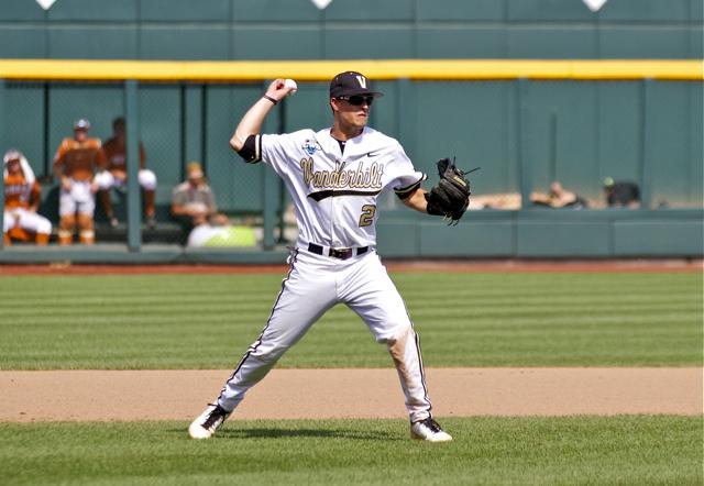 Tyler-Campbell-throws-to-first.-Photo-Shotgun-Spratling