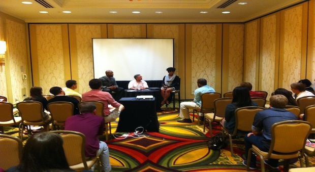 David Lankster Sr. (left) and Kimberly Monroe speak at the 2013 ACP/CMA National College Media Convention in New Orleans during a session organized and moderated by Gary Metzker.