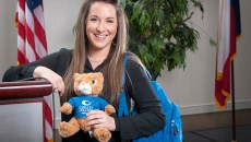Carly Patterson poses with stuffed cougar
