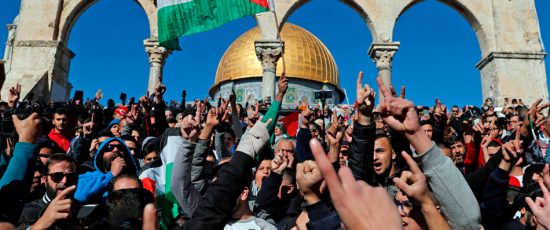 TOPSHOT - Palestinian Muslim worshippers shout slogans during Friday prayer in front of the Dome of the Rock mosque at the al-Aqsa mosque compound in the Jerusalem's Old City on December 8, 2017. Israel deployed hundreds of additional police officers following Palestinian calls for protests after the main weekly Muslim prayers against US President Donald Trump's recognition of Jerusalem as Israel's capital. / AFP PHOTO / Ahmad GHARABLI        (Photo credit should read AHMAD GHARABLI/AFP/Getty Images)