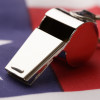 Close-up Of Metal Sport Whistle On American Flag