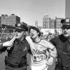 Rosie Ruiz, center, is helped by Boston police after winning the women's division of the Boston Marathon, April 21, 1980. Ms. Ruiz had a partial unofficial time of 2 hours, 31 minutes, and may have broken the women's record set in 1979. (AP Photo)