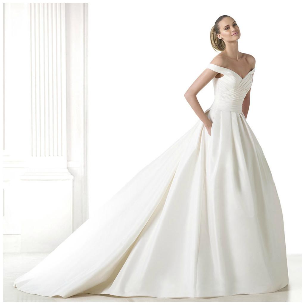 15 top wedding trends for trending wedding dresses Full skirt off the shoulder wedding dress from Pronovias