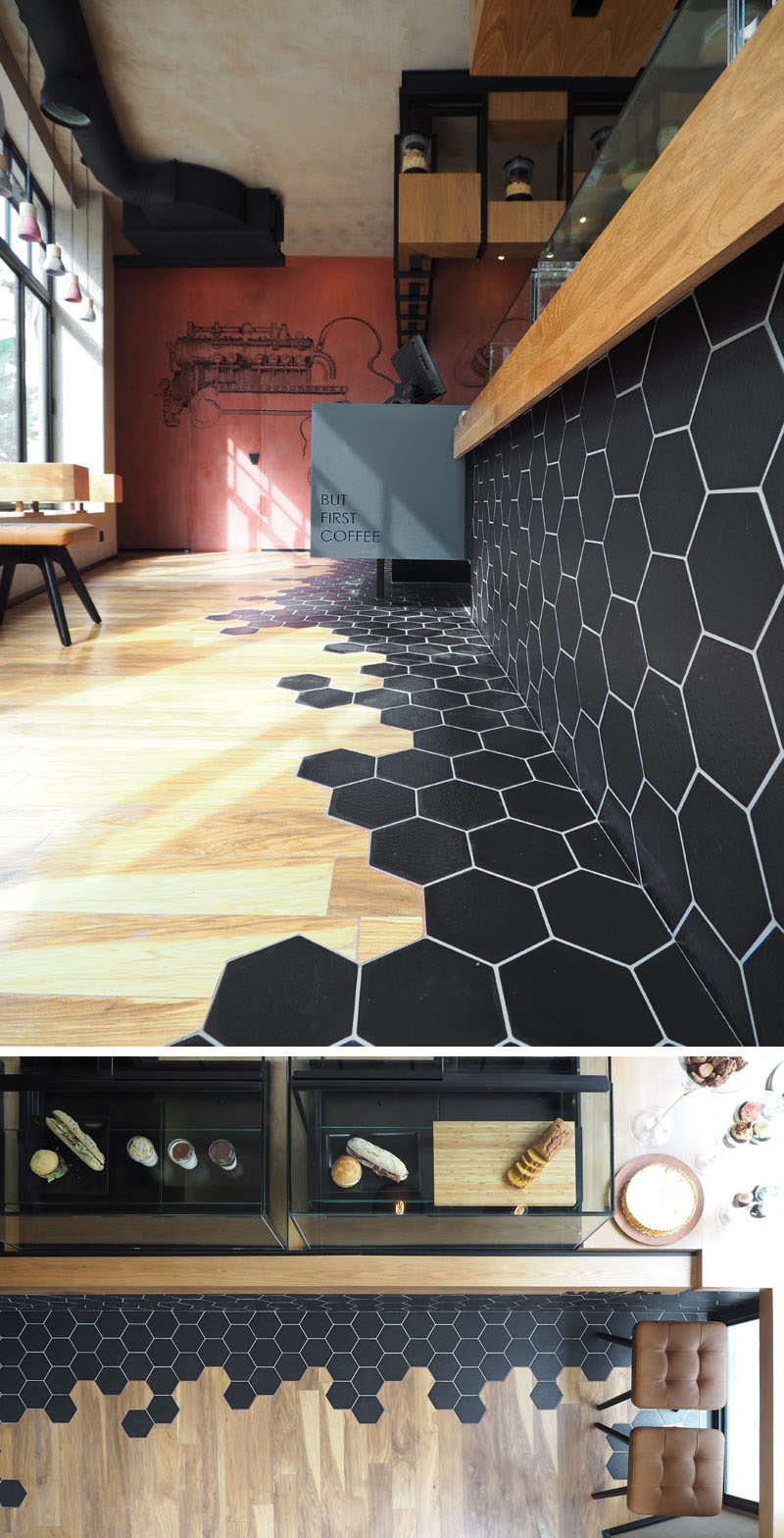 Captivating Black Hexagon Tiles This Hexagon Tiles Transition Into Wood Ing Inside This Cafe Black Hexagon Tile Kitchen Black Hexagon Tiles Nz Wood Laminate Ing Are A Design Element houzz-03 Black Hexagon Tile