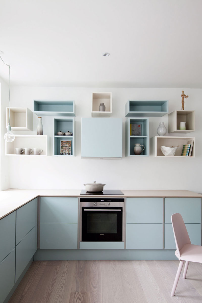 kitchen color inspiration 12 shades of blue cabinets blue cabinets kitchen A soft blue has been used on the lower cabinets as well as on and inside of some of the upper open box shelves to create a bright welcoming kitchen