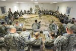 U.S. Army soldiers assigned to 12th Combat Aviation Brigade and paratroopers assigned to 1st Squadron (Airborne), 91st Cavalry Regiment, 173rd Infantry Brigade Combat Team (Airborne) conduct a pre-mission brief for an air assault mission at the 7th Army Joint Multinational Training Command's Hohenfels Training Area, Germany, March 19, 2014. (U.S. Army Photo by Visual Information Specialist Markus Rauchenberger/released)