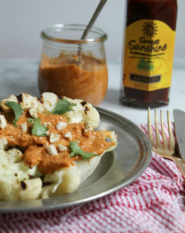 Grilled Cauliflower Steaks with Jamaican Jerk Cashew Sauce - Get the recipe for this delicious meatless meal on Cooking with Books