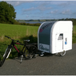 The Wide Path Camper can be pulled by a bicycle