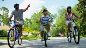 african-american-family-riding-bicycles