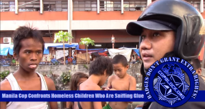 Manila Cop Confronts Homeless Children Who Are Sniffing Glue