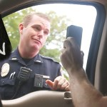 "VIDEO: Cop Falls For ""Driving on Cell Phone"" Prank; TWICE!!"