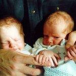 Twins-babies-hold-hand-935969_10151769984764652_40315158_n