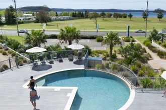 Corrigans Cove resort overlooking Corrigans Reserve and Beach with solar heated pool