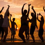 Silhouette of People Dancing On Beach at Sunset; Shutterstock ID 179939357; PO: summer-music-dance-songs-playlist-stock-today-tease-150616; Client: TODAY Digital