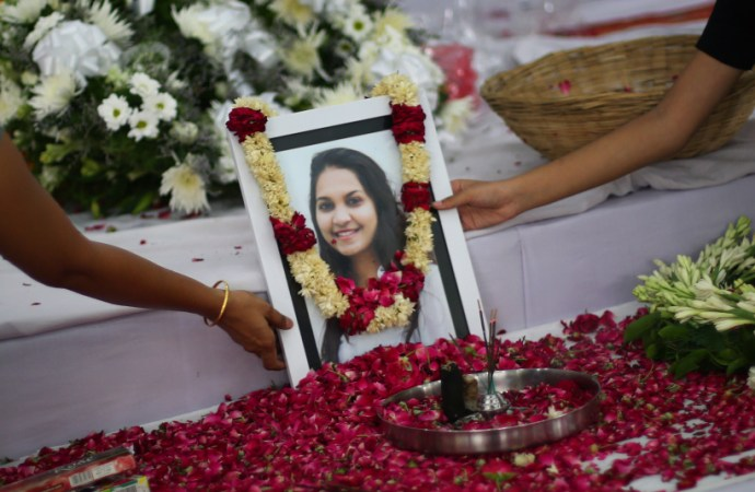 A portrait of Tarishi Jain, a victim of the attack on Dhaka's Holey Artisan Bakery, is laid out for people to pay respect during a memorial service before her cremation in Gurgaon on Monday. Express photo by Oinam Anand. 04 July 2016