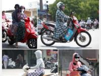 Women protecting themselves from sun in Vietnam. Illegal in France