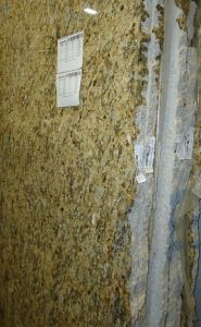 Granite_slabs_standing_vertically_in_a_warehouse