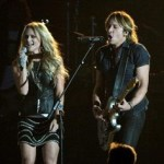NASHVILLE, TN - NOVEMBER 06:  Miranda Lambert and Keith Urban perform onstage during the 47th annual CMA Awards at the Bridgestone Arena on November 6, 2013 in Nashville, Tennessee.  (Photo by Rick Diamond/Getty Images)