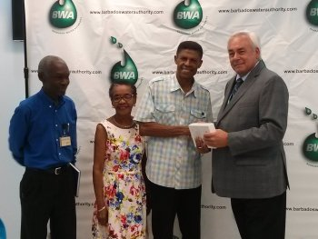 Left to right: Dr. John Mwansa (General Manager of BWA, Ms. Yvette Collins (wife), Mr. Hallum Collins (prize-winner), David McCartney (Cowater's Team Leader