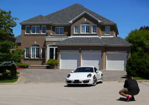 Porsche dealer puts your house in direct marketing material Guerrilla Marketing Photo