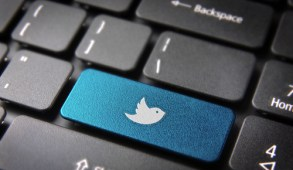 Socialmedia key with twitter bird icon on laptop keyboard. Included clipping path, so you can easily edit it.
