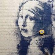 girl-pierced-eardrum-banksy