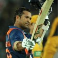 Sachin Tendulkar raises his bat after scoring on eof his magnificent ODI centuries