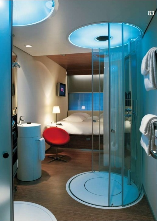 light blue of shower and bed and whole room