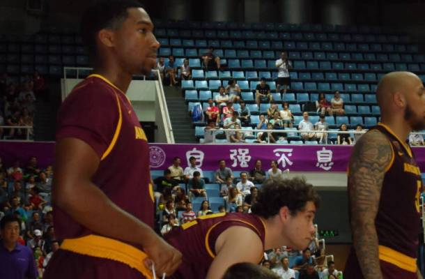Chance Murray (left) warms up during an ASU game in China.
