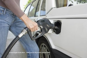 120-Y9IL56J65J5-Glowimages-filling-a-gas-tank