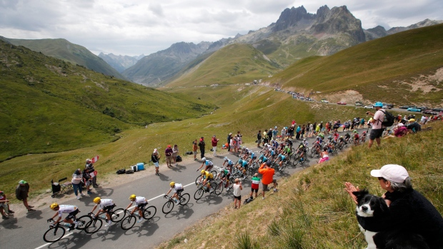 TOUR 2018  Route highlights of the Tour de France   CTV News     shows Britain s Chris Froome  wearing the overall leader s yellow  jersey  as he follows his Sky teammates as they set the pace when climbing  Croix de
