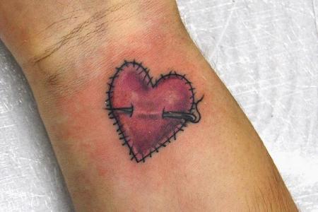 1 heart tattoo