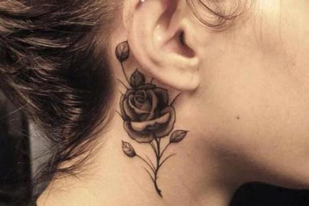 14 small black and white rose tattoo on neck