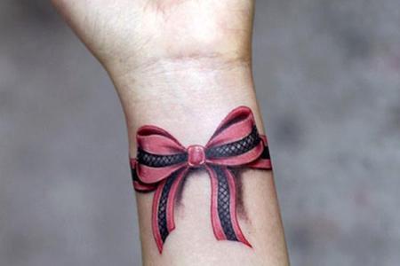 17 wrist bow tattoo