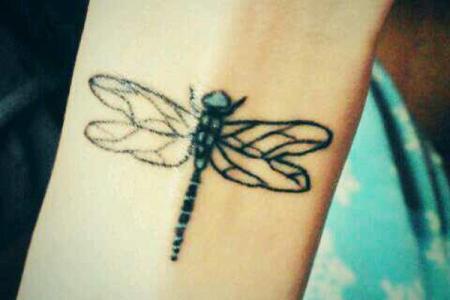 45 dragonfly tattoo on wrist