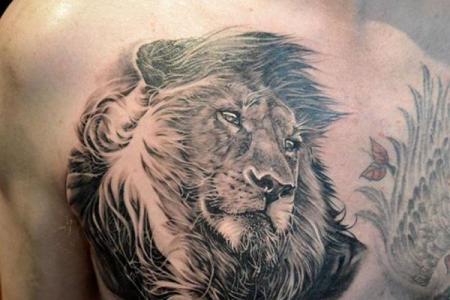 11 lion tattoo