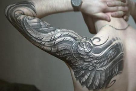 17 wing arm tattoo
