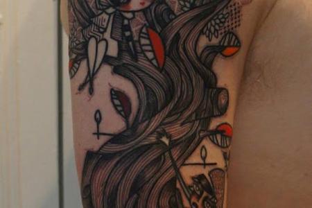 34 cartoon arm tattoo