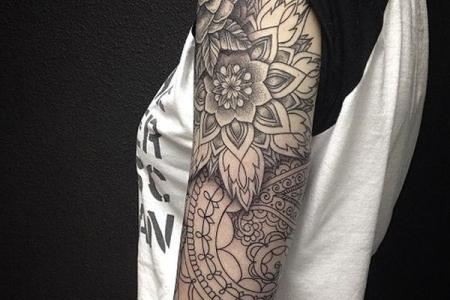 45 black and white arm tattoo