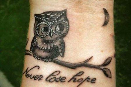 12 owl tattoo on wrist1