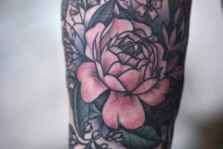 8 flower forearm tattoo